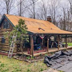 A log cabin roof replacement in Madison, CT